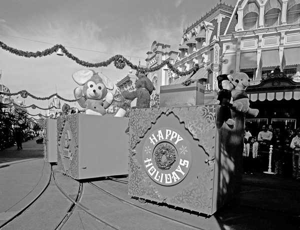 "These pictures show what the Christmas parade at Walt Disney World looked like in 1976. The box of toys start off the parade with ""Happy Holidays"" written on the side of one of the boxes."