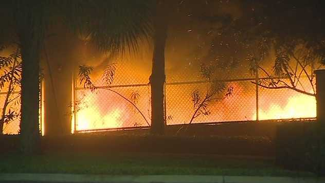 Several cars went up in flames on Wednesday morning inside an Orlando parking garage and authorities are investigating it as suspicious.