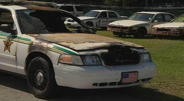The Marion County Sheriff's Office, along with the State Fire Marshal's Office and the Ocala Police Department, are looking for the person responsible for setting fire to several law enforcement vehicles.