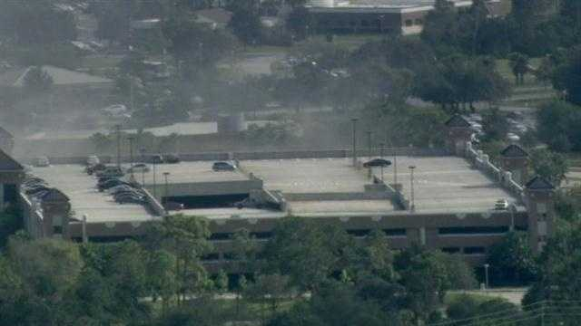 Two vehicles caught fire in a University of Central Florida parking garage Thursday afternoon.