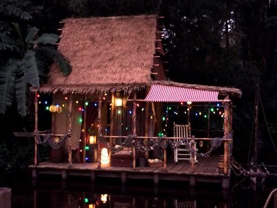 Twinkle lights among the final touches for the Jingle Cruise.
