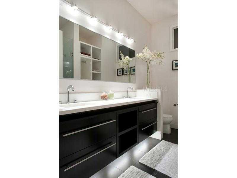 The apartment's bathroom will impress any guest.