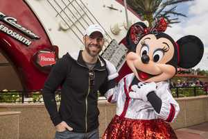 """Singer Chris Daughtry, lead singer of the band """"Daughtry,"""" posing with Minnie Mouse in front of the Rock 'n' Roller Coaster on Nov. 13, 2013."""