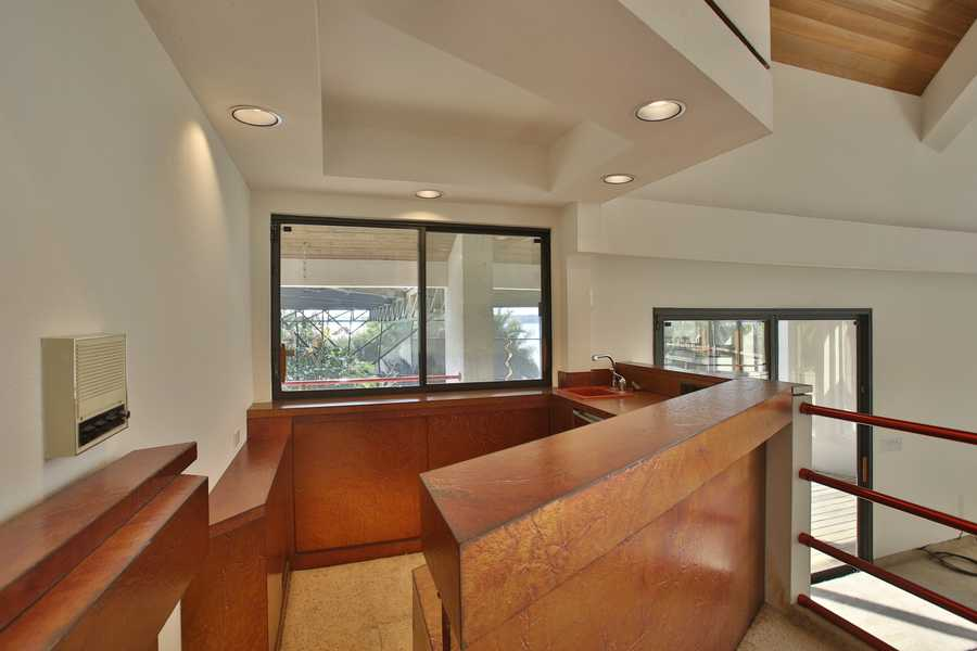 A beautiful wet bar opens to the family room as well as the screened pool deck for both indoor and outdoor entertaining.