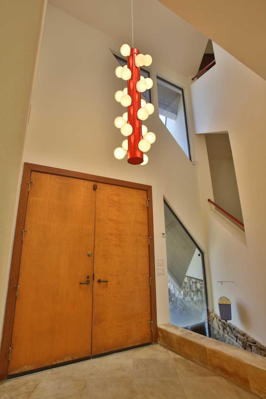 Foyer features vaulted ceiling and Brazilian quartz tile.