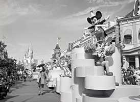 Some familiar faces are in the parade along with Mickey in this picture.  Can you name them?