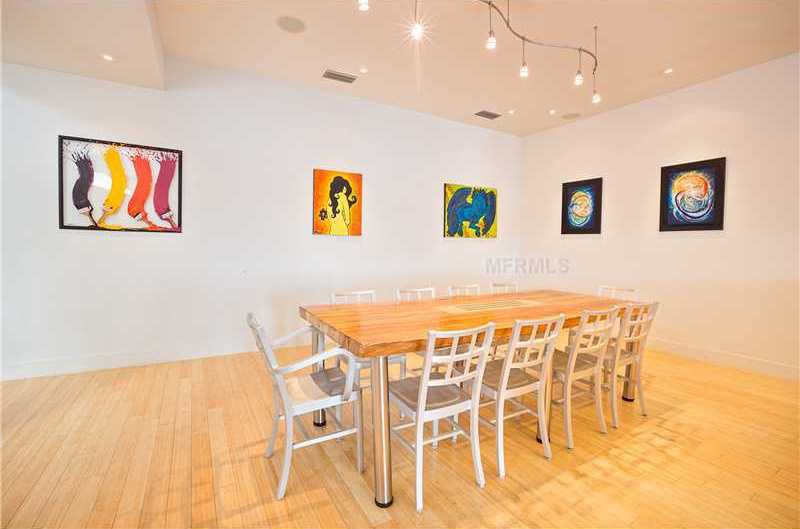Casual dining with a modern edge in this tastefully artistic dining room.