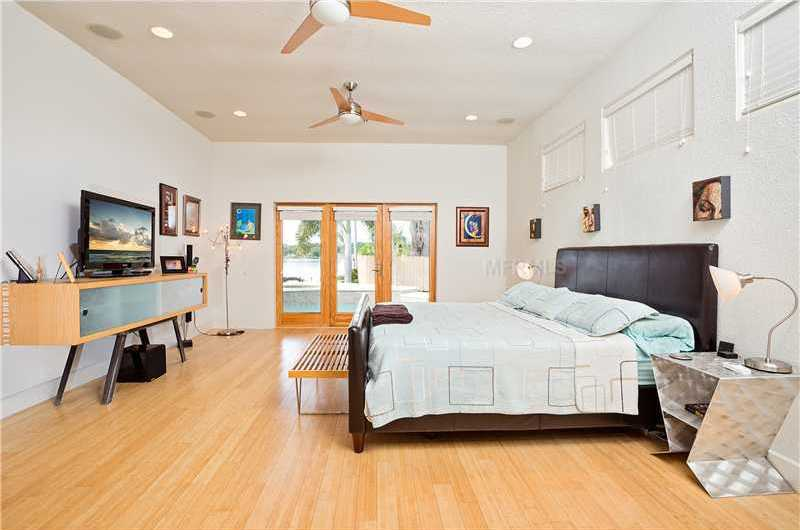 The master bedroom is not only spacious but also features private access to the jacuzzi.