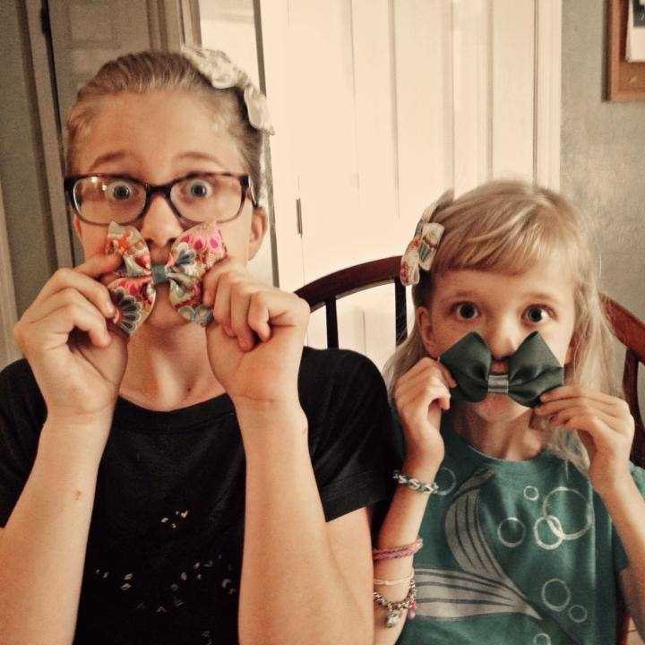 Abbey (left) and Izzie (right) showing off the merchandise Abbey made for Bows for Boo Boo.