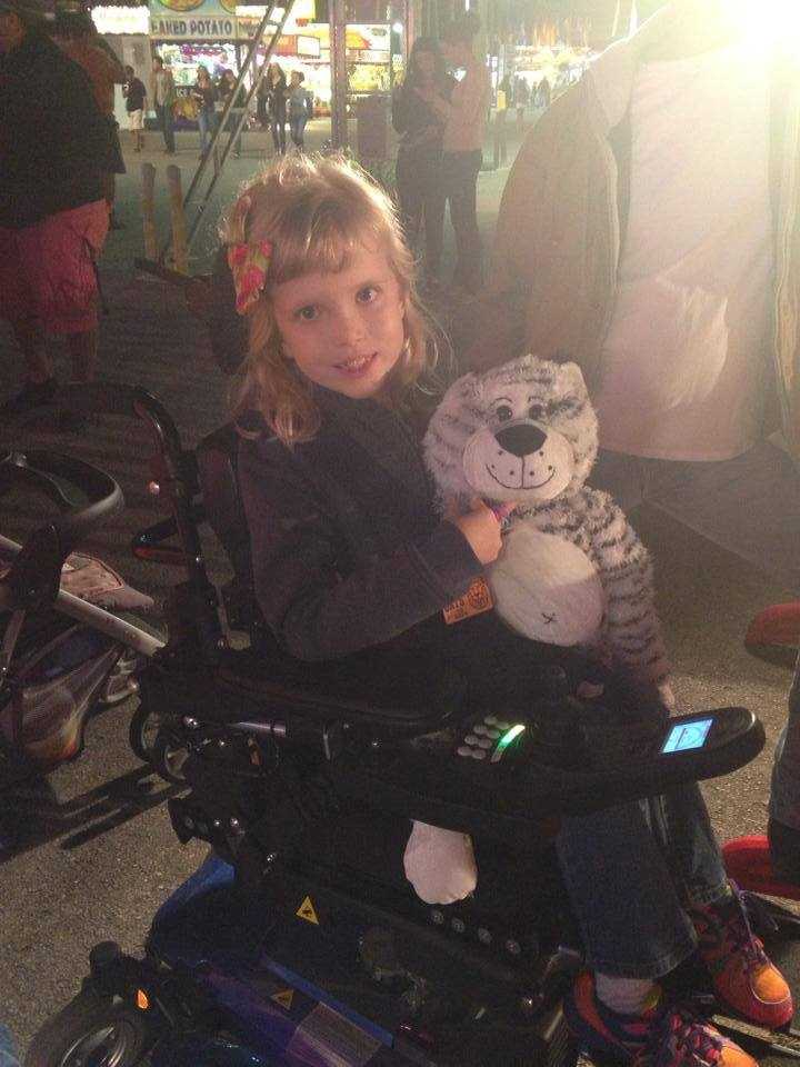 Izzie has congenital muscular dystrophy, a disease that doesn't allow her to walk.