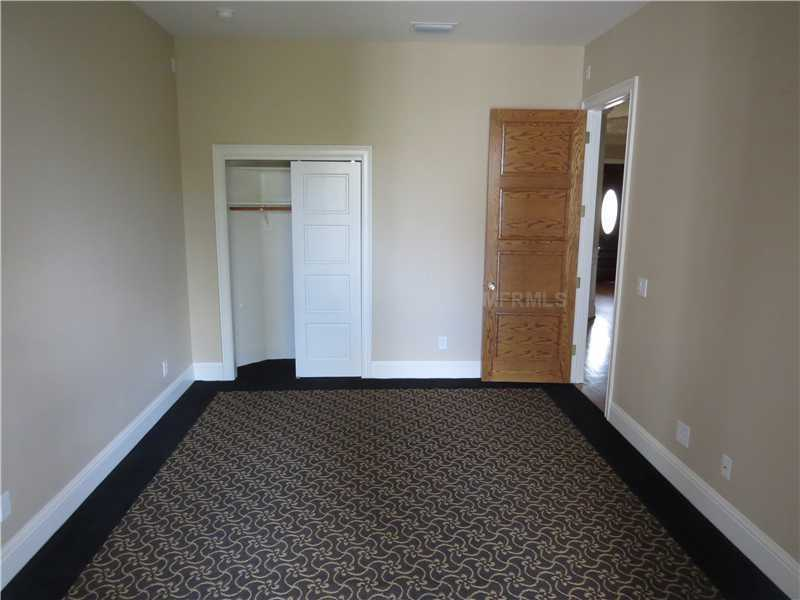 Possible guest bedroom or private office.
