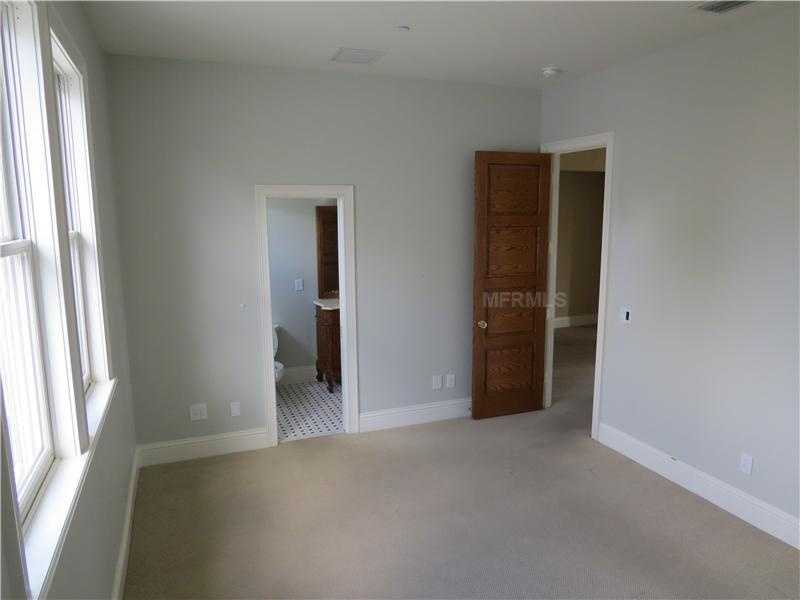 In addition, this same room features beautiful windows and an en-suite bathroom.