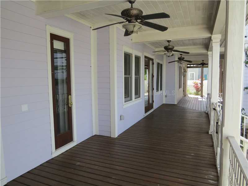 Enjoy the weather on the home's full wrap-around porch.