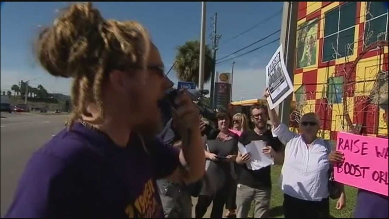 Fast food workers wanting higher wages protested in Orlando Thursday.
