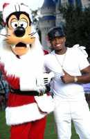 Ne-Yo and Santa Goofy hang out between performances.