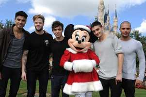 Minnie Mouse poses with the guys from The Wanted.