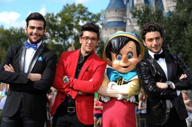 Pinocchio and IL VOLO take a break in front of Cinderella's Castle.