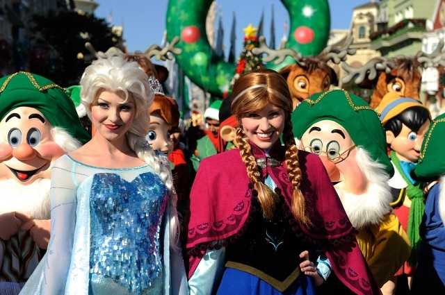 "Disney characters Elsa and Anna (right) from Disney's ""Frozen"" also taped a segment for the Disney Parks Christmas Day Parade at the Magic Kingdom."