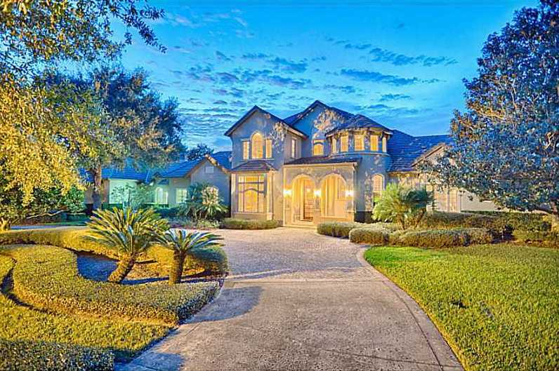 Only a fence separates this expansive six bedroom, eight bathroom mansion's putting green from the world-renowned Isleworth golf course. Begin your tour now and don't forget to stop by the theater.