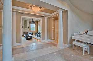 Directly in front of the foyer is the home's luxurious movie room.