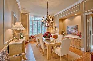 A formal dining room looks out over the almost one-acre estate.