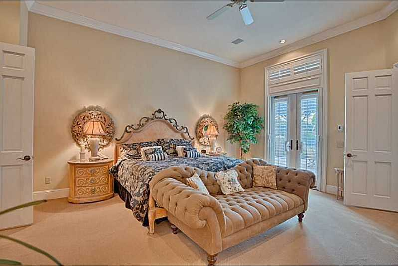 The secluded master suite occupies the right wing of the home.