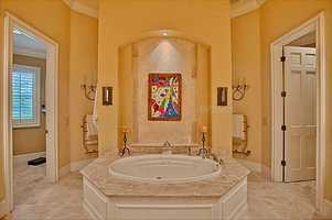 The master bedroom features a resort-style spa tub.