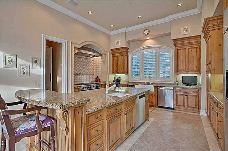 An open-layout summer kitchen features a host of impressive upgrades.