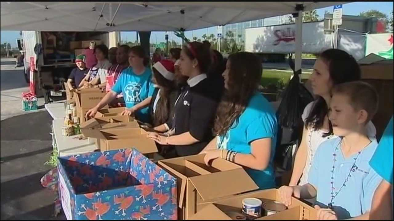 WESH 2's 28th annual Share Your Christmas food drive got off to a rocking start with 14,322 pounds of food and $7,600 in donations collected Monday in Volusia County.