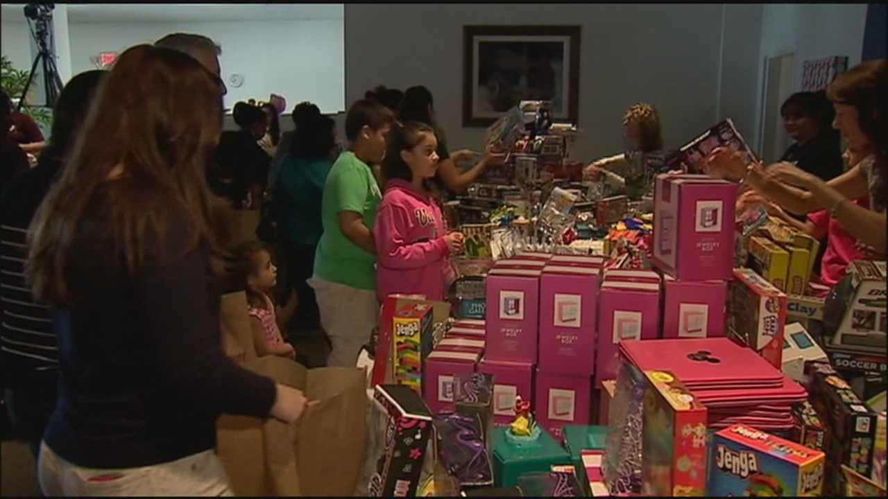 More than 1,000 families in Sanford shopped for Christmas toys for free Saturday.