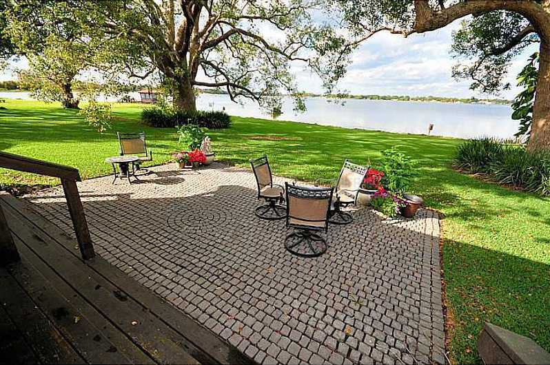 Enjoy the beautiful view from the brick-laden uncovered patio.