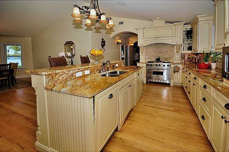 The kitchen is a chef's delight with hand-carved deluxe cabinetry, top-of-the-line stainless steel Viking Appliances and imported granite countertops.