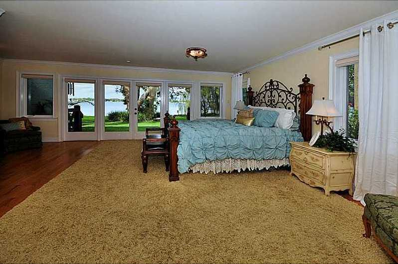 Enjoy cool, romantic evenings by opening the glass French doorsto Lake Fairview from the first floor master bedroom.