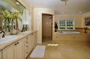 The master bathroom is equally grand with Florentine marble flooring throughout, plenty of natural lighting and lush garden tub sure to enchant after a long hard day.