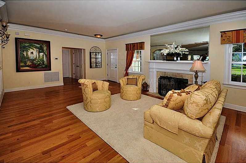 The living room also boasts a fireplace and beautiful mantel.