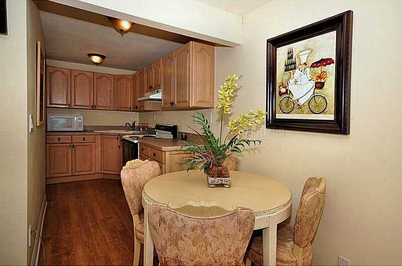Welcome your guests with a private wing of the home on the upstairs level that can also be utilized as a mother-in-law suite complete with a deluxe bedroom, full bath, living room and working kitchen.