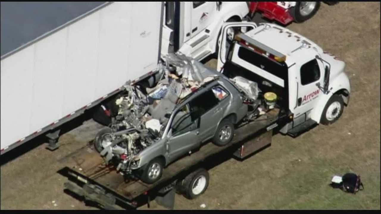 Woman dies after slamming SUV into parked tractor-trailer