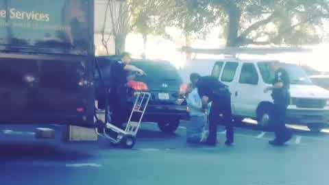 Raw video: 74-year-old arrested after pulling gun on UPS driver, officials say