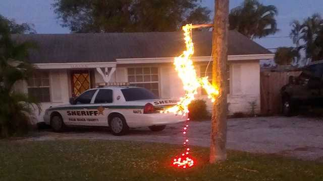 This display outside a deputy's Palm Beach Gardens home is getting mixed reaction from neighbors.