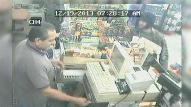 Surveillance video shows the moments a Seminole County convenience store clerk was held up at gunpoint.