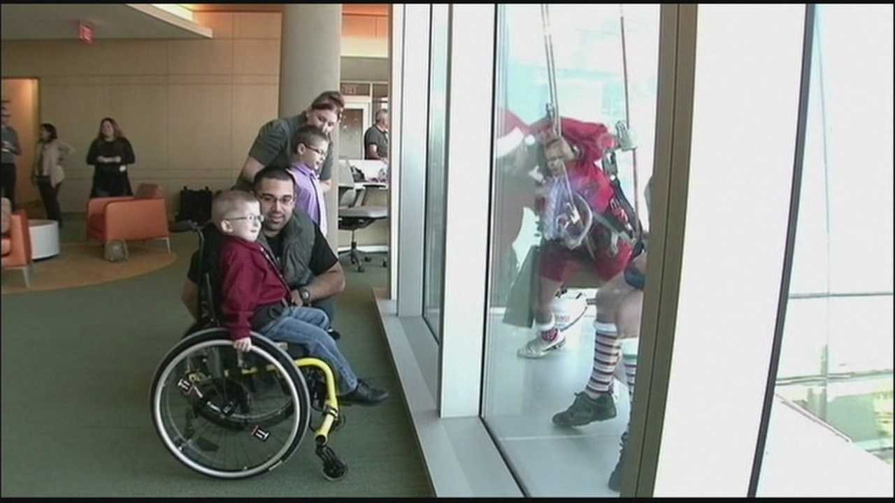 Santa and his elvers surprised some sick children stuck in an Orange County hospital this Christmas.