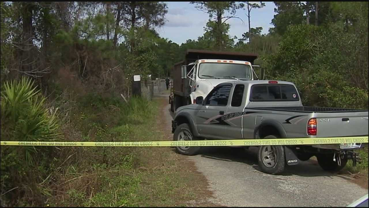 A 911 call details the confusing moments after a man was killed by a stray bullet while working in his Deltona backyard on Christmas Day.
