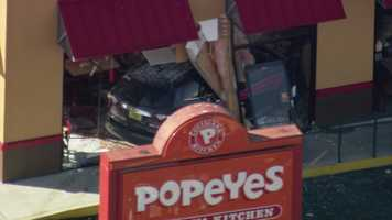 Five people were hurt when a vehicle crashed into a Popeyes restaurant Monday afternoon.