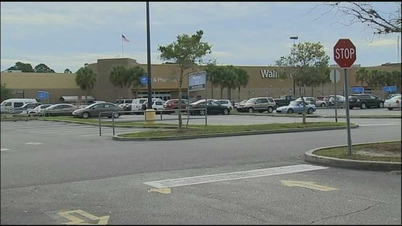 A Walmart manager went on a wild ride in Cape Canaveral after chasing suspected beer thieves and jumping in the back of their truck Monday.