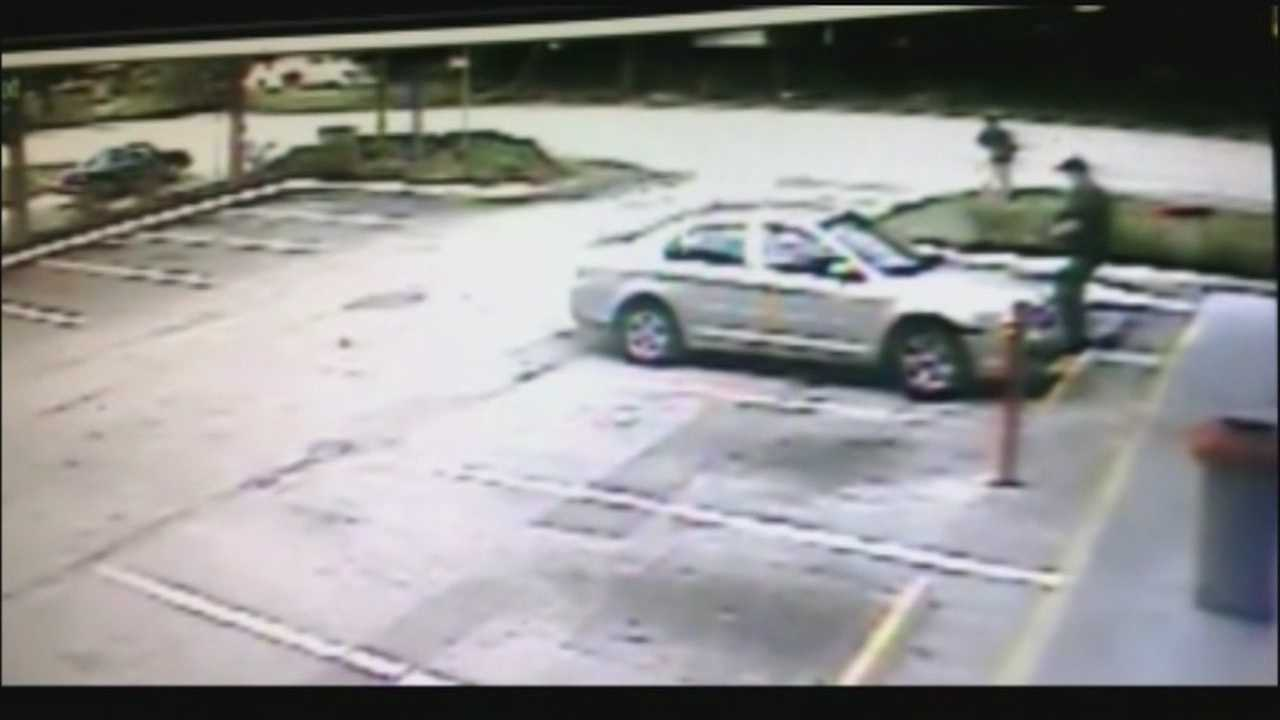 Surveillance video shows KFC worker robbed in parking lot