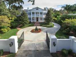 Sitting on a 1.35 acre lot on Edgewater Drive in Orlando, this three-story mansion features 6 bedrooms, 7 bathrooms, a home theater, an elegant bar and its own private beach.