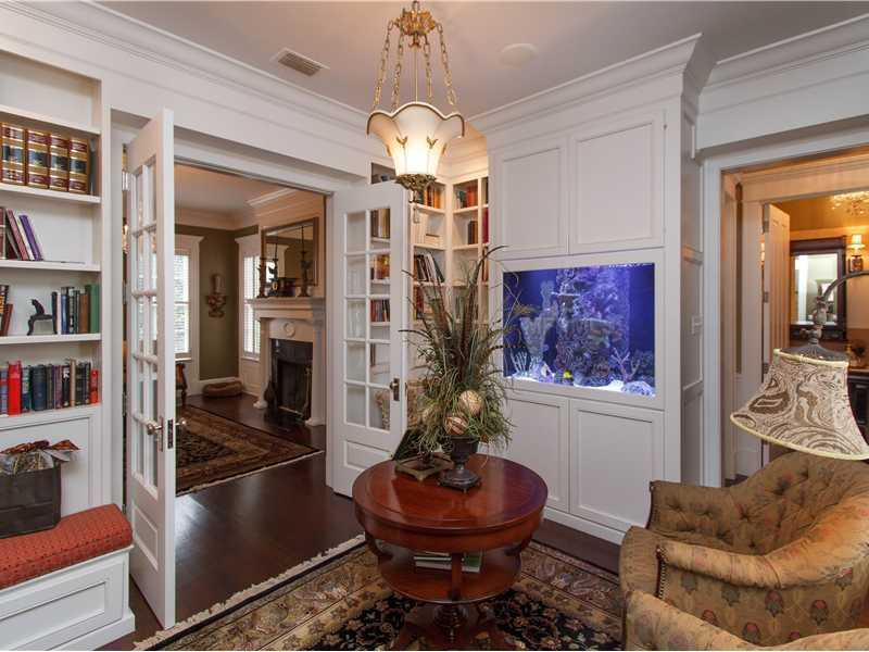 Opulent accents, such as this beautiful fish tank, add touches of elegance throughout the home.