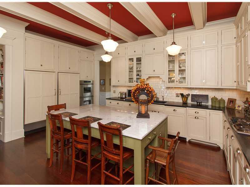 The marble-topped kitchen island also includes comfortable seating for five.