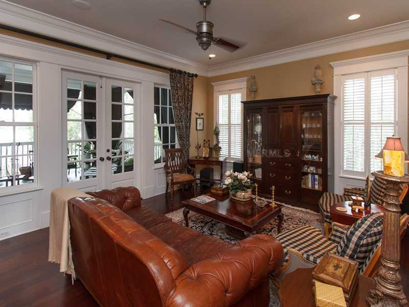 Next to the kitchen is the family room. It's comfy, casual, and provides access to the porch.
