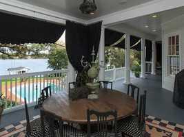 The 880 sq. ft. covered veranda offers beautiful lake views.